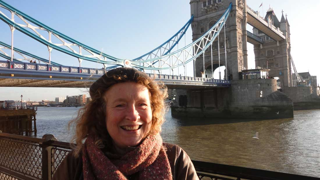 Tour guide Angela Akehurst beside Tower Bridge, London